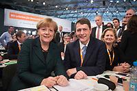 09 DEC 2014, KOELN/GERMANY:<br /> Angela Merkel (L), CDU, Bundeskanzlerin, und Dietrich Wersich, MdHB, Fraktionsvorsitzender der CDU Fraktion in der Hamburger Buergerschaft und Spitzenkandidat der Hamburger CDU fuer die Buergerschaftswahl 2015, CDU Bundesparteitag, Messe Koeln<br /> IMAGE: 20141209-01-077<br /> KEYWORDS: Party Congress