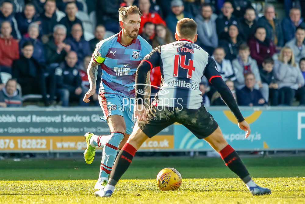 Genseric Kusunga of Dundee FC takes on Brad Lyons of St Mirren during the Ladbrokes Scottish Premiership match between St Mirren and Dundee at the Paisley 2021 Stadium, St Mirren, Scotland on 30 March 2019.