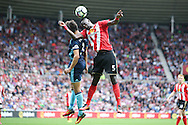 Sunderland defender Papy Djilobodji (5)  gets up ahead of Middlesbrough defender George Friend (3)  during the Premier League match between Sunderland and Middlesbrough at the Stadium Of Light, Sunderland, England on 21 August 2016. Photo by Simon Davies.
