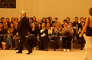 Karl Lagerfeld, Kirsten Scott thomas and Kylie Minogue amongst others in the front row during the Chanel couture fashion show, Paris, 20 January 2004. © Copyright Photograph by Dafydd Jones 66 Stockwell Park Rd. London SW9 0DA Tel 020 7733 0108 www.dafjones.com