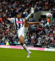 Photo: Ed Godden.<br />West Bromwich Albion v Colchester United. Coca Cola Championship. 19/08/2006. Albion's Curtis Davis fails to clear the ball.