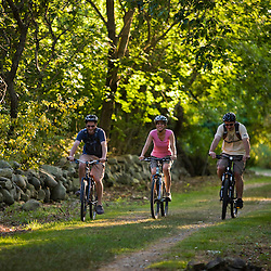 Three people biking at Odiorne State Park in Rye, New Hampshire.