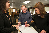 Gilford Tax Clerk Danielle LaFond, Larry Routhier and Sandra McGonagle test the Accuvote voting machines at Town Hall Tuesday afternoon in preparation for the Town Election on March 10th.   (Karen Bobotas/for the Laconia Daily Sun)