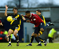 Photo. Chris Ratcliffe<br />Southend United v Bristol Rovers. FA Nationwide 3rd Division. 20/12/2003<br />Christan Edwards of Bristol goes in for the ball wth Tes Bramble of Southend