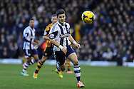 Shane Long of West Brom in action. Barclays Premier league, West Bromwich Albion v Hull city at the Hawthorns in West Bromwich, England on Saturday 21st Dec 2013. pic by Andrew Orchard, Andrew Orchard sports photography.
