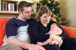 Young couple with their baby son at Christmas,