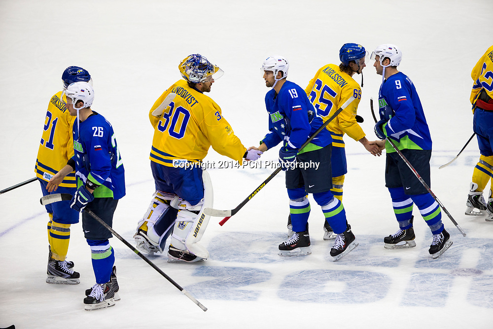Team handshake at end of Sweden vs Slovenia game at the Olympic Winter Games, Sochi 2014