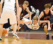 NEWS&GUIDE PHOTO / PRICE CHAMBERS.Jackson seniors Sky Garnick, left, and Mason Davis do combat for the ball during their 3A state tournament game on Saturday in Casper. Pinedale's Wes Werbelow takes the fall as the three players scramble for possesion. The Broncs lost to the Wranglers in overtime 55-52, leaving them in sixth place for the season.