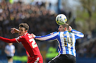 Sheffield Wednesday striker Gary Hooper (14) wins the header during the Sky Bet Championship match between Sheffield Wednesday and Cardiff City at Hillsborough, Sheffield, England on 30 April 2016. Photo by Phil Duncan.