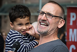 """© Licensed to London News Pictures . 16/08/2015 . Manchester , UK . Actor CHRISTOPHER ECCLESTON amongst people reading an account of the """" Peterloo """" massacre at a memorial at the site of St Peter's Field , where fifteen people were killed during a cavalry charge on a democracy protest , 196 years ago (16th August 1819) . Photo credit : Joel Goodman/LNP"""