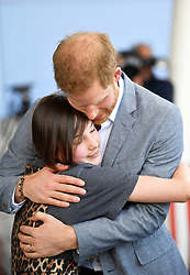 The Duke of Sussex embraces former patient Daisy Wingrove during a visit to Oxford Children's Hospital, based at the John Radcliffe hospital site in Oxford.