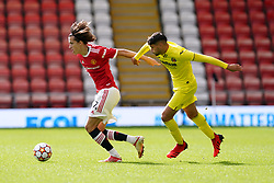 Manchester United's Alvaro Fernandez (left) and Villareal's Antonio Pacheco Ruiz battle for the ball during the UEFA Youth League, Group F match at Leigh Sports Village, Manchester. Picture date: Wednesday September 29, 2021.