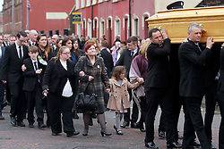 © Licensed to London News Pictures. 22/03/2016. Belfast, Northern Ireland, UK. Friends and family carry the coffin of murdered prison officer Adrian Ismay to Woodvale Methodist church. Mr Ismay died following a booby-trap bomb that exploded under his van in East Belfast on March 4th. Photo credit: Peter Morrison/LNP