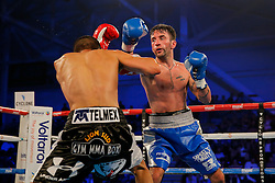 Lee Haskins (blue/white shorts) defeats Ivan Morales (black/white shorts) by unanimous decision to keep the IBF World Bantamweight Title - Mandatory byline: Rogan Thomson/JMP - 14/05/2016 - BOXING - Ice Arena Wales - Cardiff, Wales - Lee Haskins v Ivan Morales - IBF World Bantamweight Title.