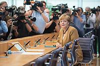 18 JUL 2014, BERLIN/GERMANY:<br /> Angela Merkel, CDU, Bundeskanzlerin, vor Beginn der sog. Sommer-Pressekonferenz der Bundeskanzlerin zu aktuellen Themen der Innen- und Außenpolitik, Bundespressekonferenz<br /> IMAGE: 20140718-01-007<br /> KEYWORDS: Kamera, Camera, Journalist, Journalisten, Fotografen, Kameraleute
