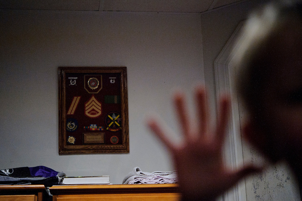 photo by Matt Roth.Wednesday, April 11, 2012..Ron's medals from his time serving in the Marines are hung on his parents' basement wall, where he and his children are living before Ron graduates from McDaniel College and moves his family to Alaska to meet up with his wife. Miles Shriver acts in a manner typical to a five year old in the foreground. ..Ron Shriver grew up on a large farm house in Pleasant Valley, Maryland, a small township outside Westminster. After his lease was up, he moved back to his parent's home with his two children Rory and Miles, living temporarily in their basement before graduating from McDaniel College in May. After tossing his graduation cap, he and his children will drive cross country to meet up with his wife who has been working on her graduate degree in Alaska. ..Ron Shriver is a retired marine staff sergeant. He is also the first in his family to attend college, thanks to the New G.I. Bill. His wife, a fellow retired Marine, is finishing up graduate school in Alaska. After Ron gets his undergraduate degree from McDaniel College in May, he plans to drive to Alaska with is two children Rory, 6, and Miles, 5. For the move Ron got rid of most of his family's belongings, and after his lease was up, he and his children moved back into his parent's farmhouse.
