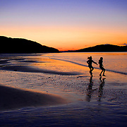 Two young girls play on the beach at Loch Morar at sunset.         Robert Perry Scotland on Sunday 11th April 2008