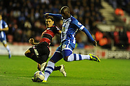 Wigan's  Marc Antoine Fortune has a shot at goal.  Skybet championship match, Wigan Athletic  v Queens Park Rangers at the DW Stadium in Wigan, Lancs on Wed 30th Oct 2013. pic by Andrew Orchard, Andrew Orchard sports photography,