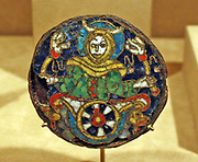 Roundel with a Personification of the Moon.  Copper alloy, iron and cloisonne enamel Carolingian.  Made about 860-90, probably in south central France.  This plaque is one of the earliest known examples in the West of the cloisonne enamel technique.