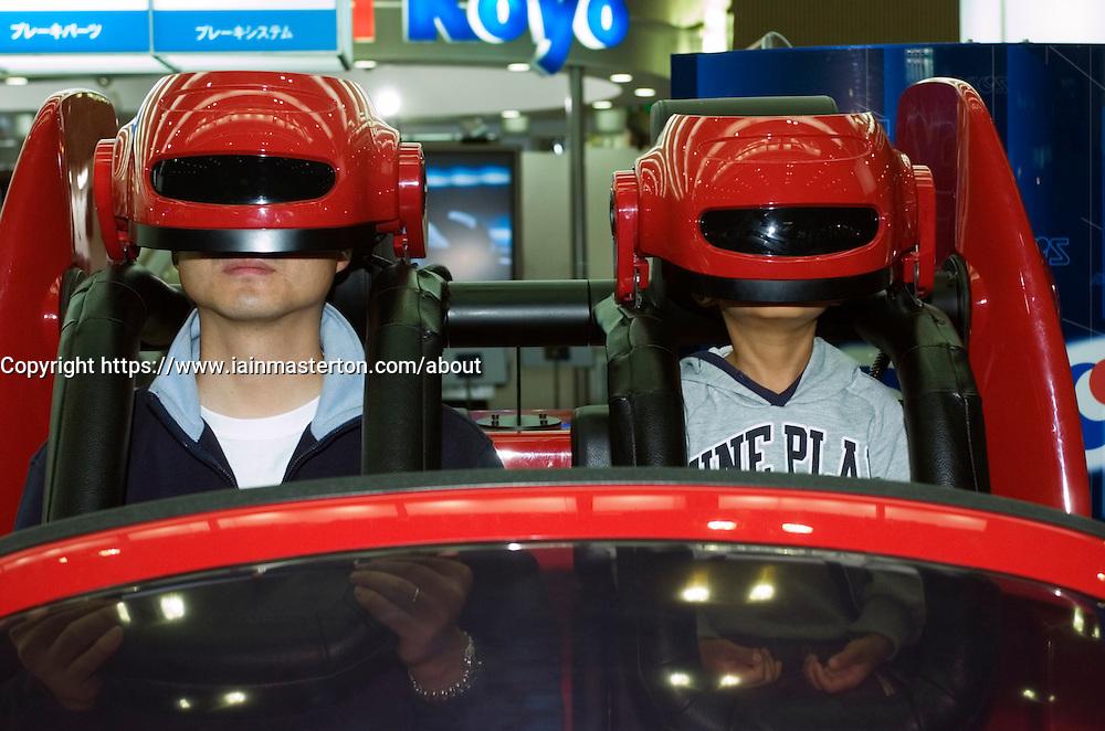 Driving simulator machine using virtual reality at the Tokyo Motor Show 2005