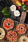 Bruschetta with tomatoes garlic basil and olive oil on Apulian bread called frisella.<br /> EXCLUSIVE ONLY ON THIS SITE!