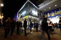 Fans make their way to the stadium prior to the Premier League match at Stamford Bridge, London.
