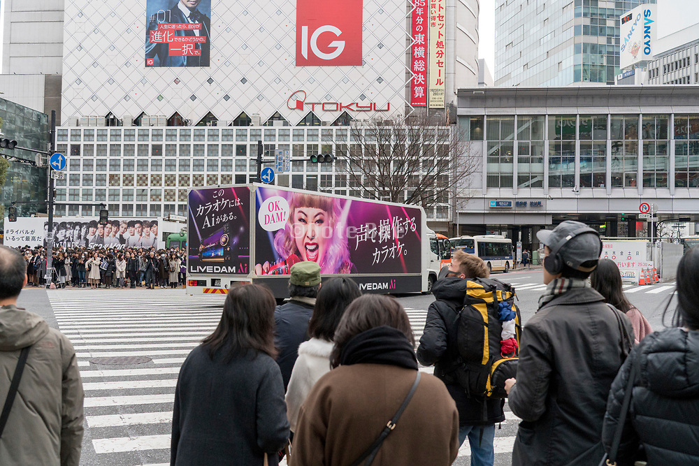 advertising truck at the famous pedestrian crossing Hachiko square Shibuya Japan Tokyo