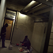 Illegal immigrants from Sierra Leone work, eat and sleep in a cellar in Amsterdam's Bijlmer area. .Picture taken 2002 by Justin Jin. ..