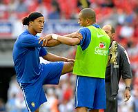 Photo: Richard Lane.<br />England v Brazil. International Friendly. 01/06/2007. <br />Brazil's Ronaldinho (lt) warms up with Gilberto Silva.