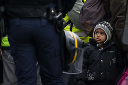 November 4, 2016 - Paris, France - A migrant waits during the evacuation of a makeshift camp near Stalingrad metro station in Paris on November 4, 2016, one of several camps sprouting up around the French capital. Over 2000 migrants were moved by police from the Paris town center to a legal migrant camp. (Credit Image: © Julien Mattia/NurPhoto via ZUMA Press)