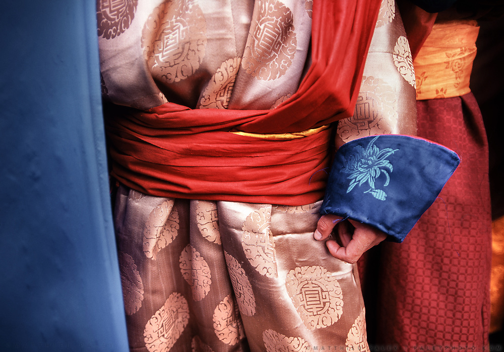 Detail of Mongolian dresses.<br /> More than a hundred people traveled by horse and foot to hear Mongolia's high Lama speak at a ceremony honoring the placement of the first stone for the Dayan Derkh monastery, which is currently being rebuilt in Khövsgöl Province. The original structure was destroyed in 1938 by Soviet purges.