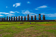 Easter Island, March 31, 2018. A row of Moais facing inward over the island. The size of the Moais can be estimated by compariing them to the people up front. Editorial Use Only.