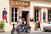 French man on Harley Davidson Motorbike at Bar La Madelon on the Champagne Tourist Route at Mancy, Champagne-Ardenne, France