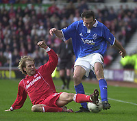 Photo. Glyn Thomas.<br /> Middlesbrough v Birmingham City.<br /> FA Barclaycard Premiership.<br /> Riverside Stadium, Middlesbrough. 20/03/2004.<br /> Boro's Gaizka Mendieta (L) slides in with a tackle on Birmingham's Stan Lazaridis.