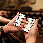 A man plays the game of dominoes in a traditional pub in Chipping, Lancashire, UK