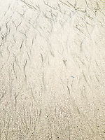 Abstract aerial view of sands on a beach in California, USA.