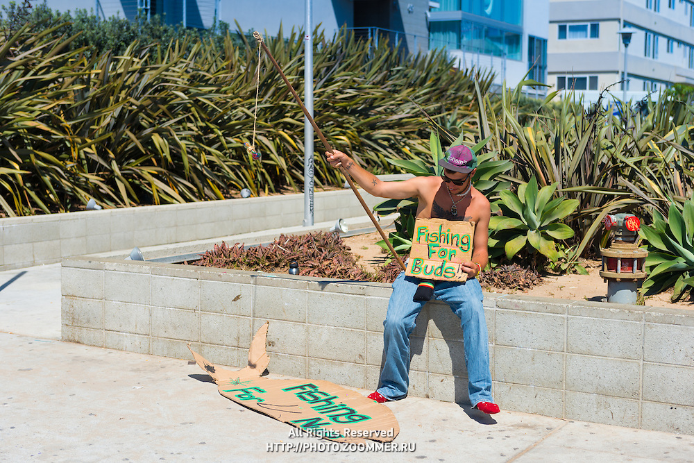 Fishing for buds on Venice beach, Los Angeles, California