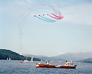 Turning tight over Lake Windemere boating are the 'Red Arrows', Royal Air Force aerobatic team during display.