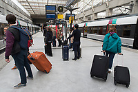 Passengers at Charles de Gaulle airport railway station where the RER B arrives and departs from.
