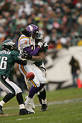 16 Jan 2005:Randy Moss of the Minnesota Vikings in hit by #54 Jeremiah Trotter of the Philadelphia Eagles during the Philadelphia Eagles 27-14 victory over the Minnesota Vikings at Lincoln Financial Field in Philadelphia, PA. <br /> Mandatory Credit:Todd Bauders/ContrastPhotography.com