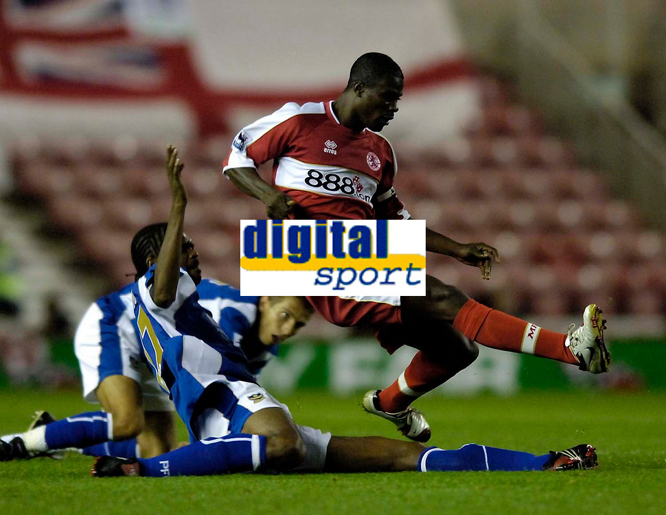 Photo: Jed Wee.<br /> Middlesbrough v Portsmouth. The Barclays Premiership. 28/08/2006.<br /> <br /> Middlesbrough's George Boateng (R) hurdles over a challenge from Portsmouth's Nwankwo Kanu.