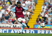 Photograph: Scott Heavey.<br />Aston Villa V Liverpool. FA Barclaycard Premiership match from Villa Park. 24/08/2003.<br />Juan Pablo Angel fires in a free-kick which smashes against the post.
