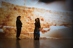 © Licensed to London News Pictures. 24/09/2018. LONDON, UK. Staff members stand next to video works by Luke Willis Thompson.  Preview of an exhibition unveiling the four artists shortlisted for Turner Prize 2018 at Tate Britain. The exhibition is open 26 September to 6 January 2019.  Photo credit: Stephen Chung/LNP