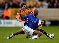 Photo: Richard Lane.<br /> Wolves v Leicester City. Coca Cola Championship.<br /> 17/09/2005.<br /> Leicester's Elvis Hammond is tackled by Wolves' Mark Kennedy.