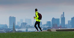 Primrose Hill, London, February 15th 2015. A runner admires the view of London's skyline on a chilly early morning on Primrose Hill, overlooking London's skyline.<br /> ///FOR LICENCING CONTACT: paul@pauldaveycreative.co.uk TEL:+44 (0) 7966 016 296 or +44 (0) 20 8969 6875. ©2015 Paul R Davey. All rights reserved.