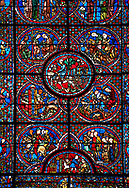 Medieval stained glass Window of the Gothic Cathedral of Chartres, France - dedicated to the Life of St Lubin . Central panel shows A barrel of wine being transported to the Cathedral, below left - The young Lubin working as a shepherd, below right - A monk gives Lubin a belt with the alphabet written on it, above left - Lubin receiving instruction from a cleric, above right - Lubin spends his spare time learning to read, while his companion idles.  Cental bottom semi circle - wine cryers, above left -a procession, above right - a procession of laymen and clerics.  A UNESCO World Heritage Site.. .<br /> <br /> Visit our MEDIEVAL ART PHOTO COLLECTIONS for more   photos  to download or buy as prints https://funkystock.photoshelter.com/gallery-collection/Medieval-Middle-Ages-Art-Artefacts-Antiquities-Pictures-Images-of/C0000YpKXiAHnG2k