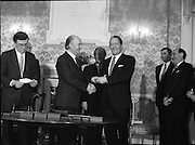 New Fianna Fáil Administration Sworn In.  (R52)..1987..10.03.1987..03.10.1987..10th March 1987..After their win in the recent general election the new Fianna Fáil government,under the leadershio of Charles Haughey, was sworn in and given their seals of offce at a ceremony in Áras an Uachtaráin today. The government received their seals from President Patrick Hillery...Photograph shows President Hillery presenting the seal of office to Tanaiste Brian Lenihan at the ceremony in the Arás