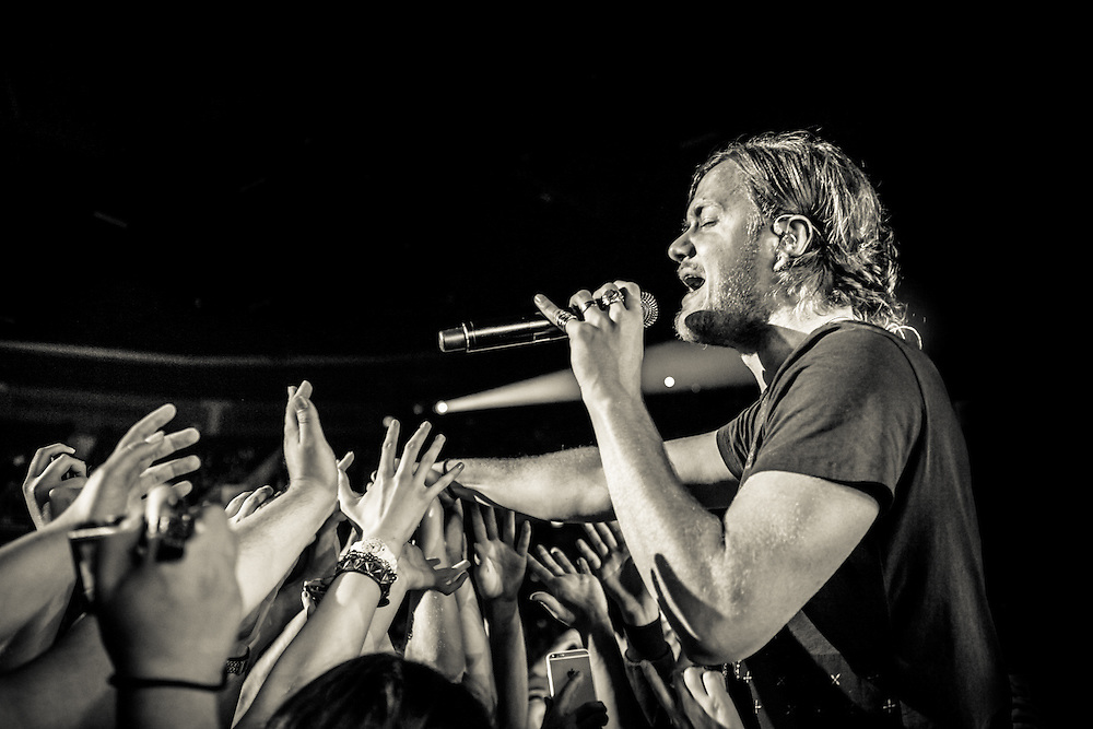 Dan Reynolds, lead vocalist of the American rock band IMAGINE DRAGONS playing live at the Koenig-Pilsener-Arena in Oberhausen, the first European show  of the Smoke + Mirrors Tour 2015.<br /> © IRIS EDINGER | Photography