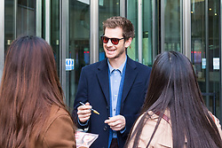London, October 22 2017. Actor Andrew Garfield signs autographs as he leaves the BBC after appearing on the Andrew Marr show at the BBC New Broadcasting House in London. © Paul Davey