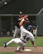 Milwaukee Brewer Fernando Vina doubles up Kansas City Royal Joe Vitiello (44) during game action at Kauffman Stadium in Kansas City, Missouri in 1995.
